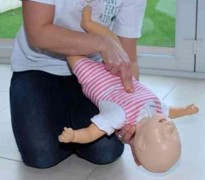 mini first aid session with baby doll
