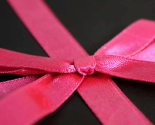 Giftfrippery box with pink ribbon