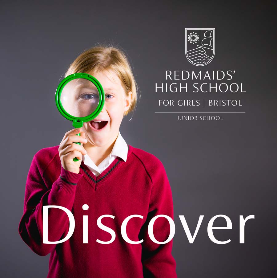 Girl in Redmaids High School Uniform with a magnifying glass